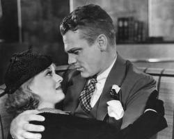 Bette Davis and James Cagney get close in Jimmy the Gent.