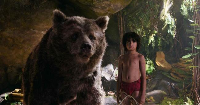 Baloo and Mowgli, played by Neel Sethi, in The Jungle Bopok