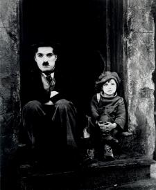 Charlie Chaplin and Jackie Coogan in The Kid.