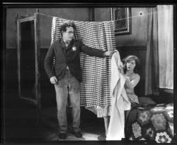 Harold Lloyd happens one night to offer shelter to Jobyna Ralston in The Kid Brother.