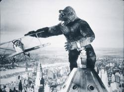 King Kong battles biplanes atop the Empire State Building in the definitive 1933 classic King Kong.