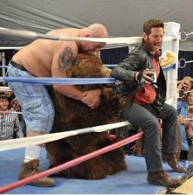Paul (The Big Show) Wight, a man in a bear costume, and Mark Feuerstein.