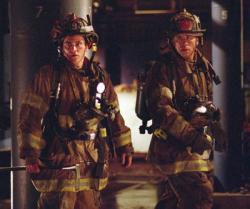 Joaquin Phoenix and John Travolta in Ladder 49.