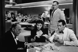 Charles Coburn, Barbara Stanwyck, William Demarest and Henry Fonda in The Lady Eve.