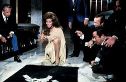 Raquel Welch shoots craps in Lady in Cement.