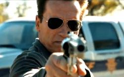 He's back! Arnold Schwarzenegger takes aim in The Last Stand.