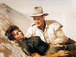 Sophia Loren and John Wayne in Legend of the Lost.