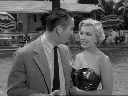 Macdonald Carey and Marilyn Monroe in Let's Make it Legal