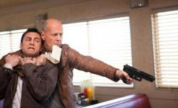Joseph Gordon-Levitt and Bruce Willis in Looper.