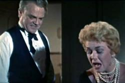 James Cagney and Doris Day argue.