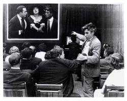 Mack Sennett and Fatty Arbuckle in the audience while Mabel Normand is on the big screen.
