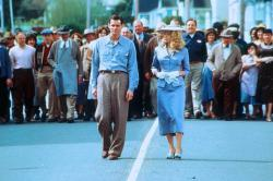 Jim Carrey and Laure Holden take a stroll while the entire town follows in The Majestic.