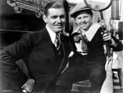 Clark Gable poses with Mickey Rooney, who played his younger self, in Manhattan Melodrama.