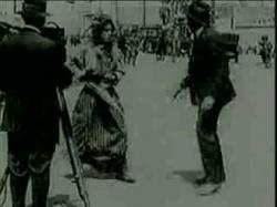 Charlie Chaplin drags it up.