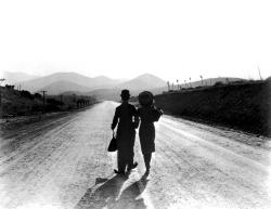 The Little Tramp and his girl head off into movie history.
