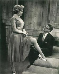 Marilyn shows off her gam to Grant.
