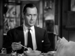 Robert Montgomery and a cat in Mr. & Mrs. Smith.