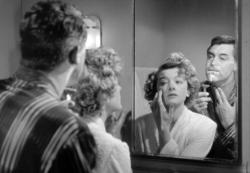 Cary Grant and Myrna Loy share a mirror in Mr. Blandings Builds His Dream House.