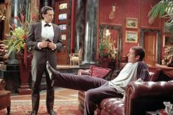 John Turturro and Adam Sandler in Mr. Deeds.