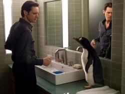 Jim Carrey and a computer generated penguin in Mr. Popper's Penguins.