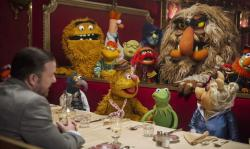Ricky Gervais and the Muppets in Muppets Most Wanted.