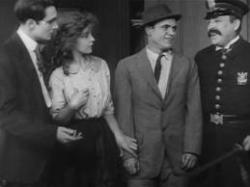 Walter Miller, Lillian Gish, Elmer Booth and John T. Dillon in The Musketeers of Pig Alley.