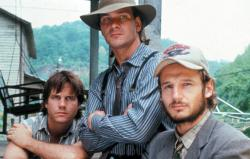 Bill Paxton, Patrick Swayze, and Liam Neeson play brothers in Next of Kin.