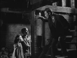 Sally Jane Bruce, Billy Chapin and Robert MItchum in The Night of the Hunter.