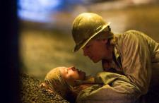 Charlize Theron and Jeremy Renner in North Country.