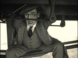 Harold Lloyd riding the rails in Now or Never
