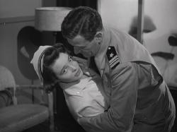 Patricia Neal and John Wayne in Operation Pacific.