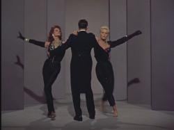 Rita Hayworth and Kim Novak dance around Frank Sinatra in Pal Joey.