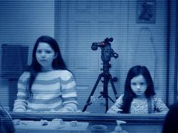 Chloe Csengery and Jessica Tyler Brown in a scene that appeared in the trailer, but never made the finished  Paranormal Activity 3.