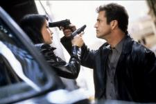 Lucy Liu getting turned on by Mel Gibsons gun.