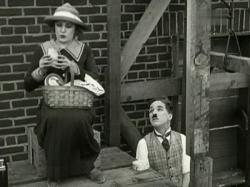 Edna Purviance and Charlie Chaplin in Pay Day.