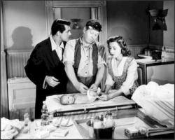 Cary Grant, Edgar Buchanan and Irene Dunne in Penny Serenade.