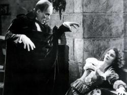 Lon Chaney and Mary Philbin ham it up in The Phantom of the Opera.