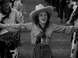 Judy Garland belts out a song in Pigskin Parade.