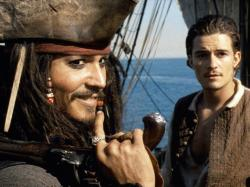 Johnny Depp and Orlando Bloom in Pirates of the Caribbean: The Curse of the Black Pearl.