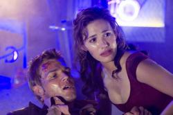 Mike Vogel and Emmy Rossum in Poseidon.
