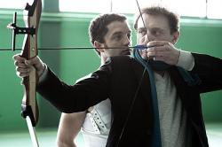 Guillaume Gouix teaches archery to Jean-Paul Rouve in Nobody Else But You.