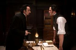 John Cusack and Luke Evans in The Raven.