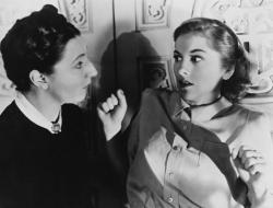 Judith Anderson as Mrs. Danvers scares the shit out of Joan Fontaine in Rebecca.
