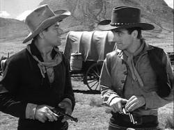 John Ireland and Montgomery Clift compare revolvers in Red River.