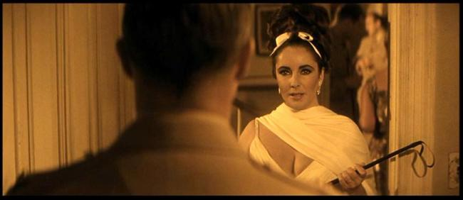 Marlon Brando about to get whipped by Elizabeth Taylor in Reflections in a Golden Eye