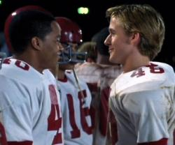 Donald Faison and Ryan Gosling in Remember the Titans.