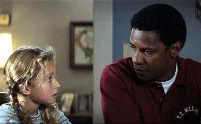 Hayden Panettiere and Denzel Washington in Remember the Titans.