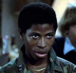 Larry B. Scott as Lamar Latrell in Revenge of the Nerds.