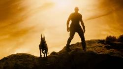 Vin Diesel and man's best friend in Riddick.