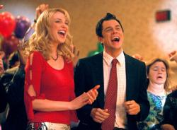 Katherine Heigl and Johnny Knoxville in The Ringer.